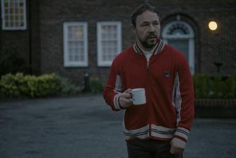Tony (Stephen Graham) outside care home